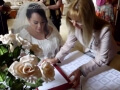 Signing the marriage certificate at home