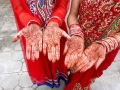 Mehndi hands ddecorations at a wedding ceremony