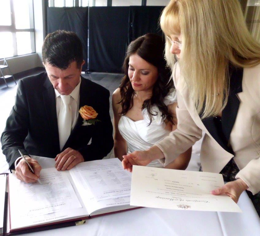 signing the marriage certificate Novotel Manly